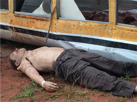 TOM Manikin under bus rescue